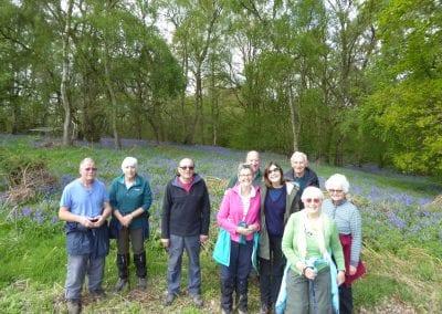 Walkers by bluebells, Hunts Bottoms